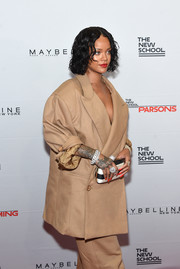Rihanna styled her oversized suit with a black-and-white striped satin clutch by Roger Vivier when she attended the Parsons Benefit.