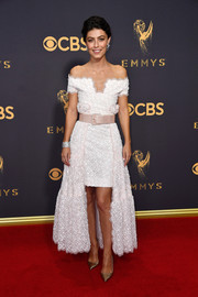 Alessandra Mastronardi kept it ladylike at the 2017 Emmys in a white Chanel Couture one-shoulder dress with a high-low hem.