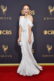 Halston Sage was trendy in a white Zac Posen cold-shoulder dress with silver beading at the 2017 Emmys.