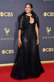 Gabrielle Union made a head-turning entrance at the 2017 Emmys in a sheer black Zuhair Murad gown with capelet detailing.