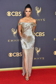 Susan Kelechi Watson radiated so elegantly in sculptural gold off-the-shoulder gown by Cristina Ottaviano at the 2017 Emmys.