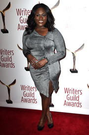 Danielle Brooks wrapped up her voluptuous figure in a ruched and ruffled silver dress by Christian Siriano for the Writers Guild Awards.