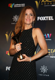 Isla Fisher paired a beautiful Bulgari diamond bracelet with a dotted dress for the AACTA Awards.