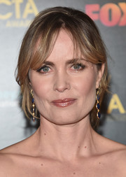 Radha Mitchell styled her hair into a loose bun with parted bangs for the AACTA International Awards.