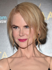 Nicole Kidman brightened up her pretty face with a swipe of fuchsia lipstick.