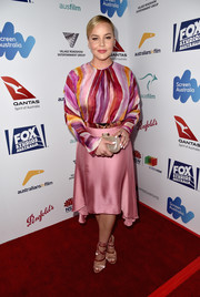 Abbie Cornish completed her colorful outfit with a pink silk skirt.