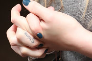 Hilary showed off her 'Shine' tattoo on her right finger.
