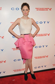 Coco Rocha flaunted her girly side in this pink peplum number at the DKMS Gala.
