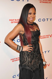 Ashanti added even more glitz and shine to her look with a metallic ruby nail polish.