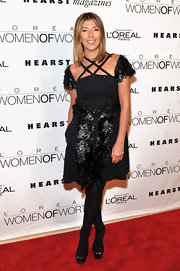 Nina Garcia wore a black textured cocktail dress for the Women of Worth Awards.