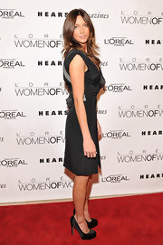Katie Cassidy donned a chic black dress paired with black satin platform pumps.