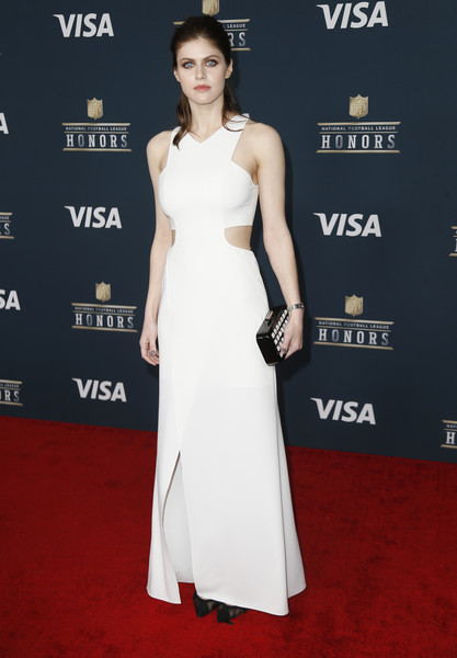 Alexandra Daddario went for a modern look in a white cutout gown by Halston Heritage at the NFL Honors.