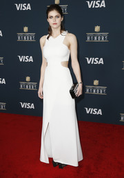 Alexandra Daddario styled her dress with a black-and-white box clutch.
