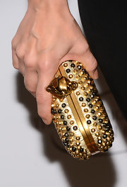 Monica Potter's gold studded clutch had a cool skull clasp that added just a touch of punk edge to her look.