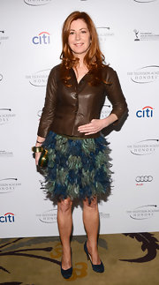 Dana paired this chocolate brown leather jacket with a feathered skirt for a cool mix of textures.