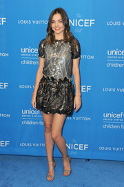 Aussie beauty Miranda Kerr had a leggy look in her metallic minidress that featured frilled details.