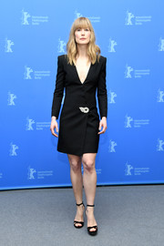 Rosamund Pike kept it simple yet sharp in a black Givenchy tuxedo dress at the Berlinale photocall for '7 Days in Entebbe.'