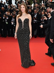 Barbara Palvin looked perfectly elegant in a crystal-embellished strapless gown by Armani Privé at the Cannes Film Festival 70th anniversary event.