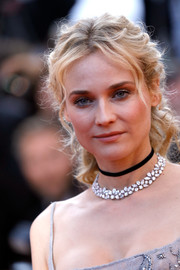 Diane Kruger accessorized with a Chopard diamond necklace along with a black choker.