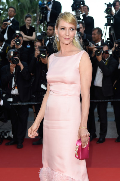 Uma Thurman tickled us pink with this Prada satin clutch and dress combo at the Cannes Film Festival 70th anniversary event.