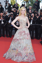 Elle Fanning looked magical in an emboidered ball gown by Christian Dior Couture at the Cannes Film Festival 70th anniversary event.