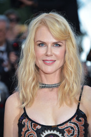 Nicole Kidman wore messy-chic waves with side-swept bangs at the Cannes Film Festival 70th anniversary event.