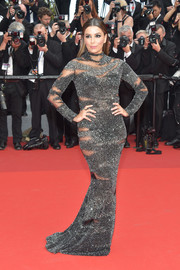 Eva Longoria was all about subtle seduction in a micro-beaded gunmetal peekaboo gown by Pamella Roland at the Cannes Film Festival 70th anniversary event.