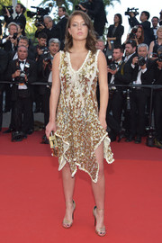 Adele Exarchopoulos matched her dress with a pair of gold ankle-strap sandals.