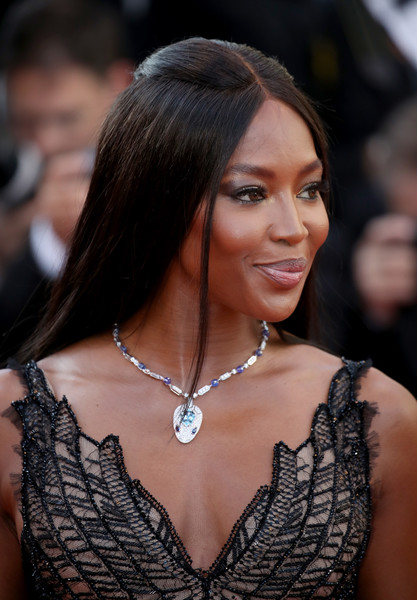 Naomi Campbell sported a simple half-up style at the Cannes Film Festival 70th anniversary event.