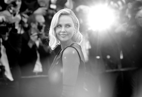 More Pics of Charlize Theron Diamond Bracelet (1 of 38) - Charlize Theron Lookbook - StyleBistro [image,photograph,white,black-and-white,monochrome,black,monochrome photography,beauty,snapshot,photography,flash photography,red carpet arrivals,charlize theron,cannes,france,cannes film festival,palais des festivals]