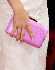 The actress added a pop of color to her Globes ensemble with a pink Kotur clutch.