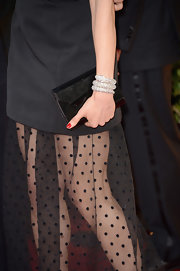 Rachel Weisz topped off her cool black look with a classic black clutch.