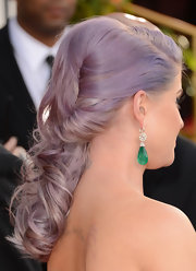 Kelly Osbourne added a pop of color to her Golden Globes gown with emerald drop earrings.