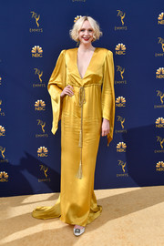 Gwendoline Christie opted for a marigold satin gown with a deep-V neckline and drapey sleeves for the 2018 Emmys.