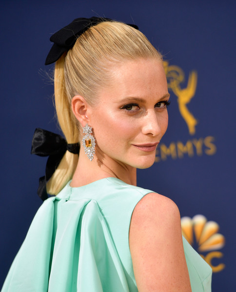 Poppy Delevingne looked adorable wearing this segmented ponytail, complete with black velvet bows, at the 2018 Emmys.