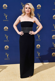 Kate McKinnon went for edgy elegance in a strapless, zip-embellished black gown by Alexander Wang at the 2018 Emmys.