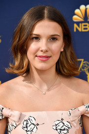Millie Bobby Brown went retro with this flippy 'do at the 2018 Emmys.