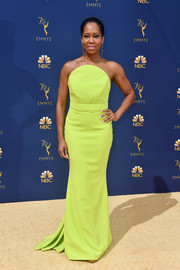 Regina King brought a bright pop of color to the 2018 Emmys with this strapless chartreuse gown by Christian Siriano.