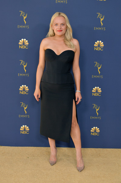 Elisabeth Moss styled her black look with embellished silver pumps by Christian Louboutin.