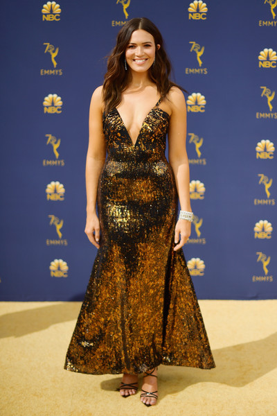 Mandy Moore looked sassy in a plunging metallic gown by Rodarte at the 2018 Emmys.