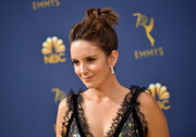 Tina Fey went for an edgy top knot at the 2018 Emmys.