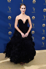 Sarah Paulson worked a strapless black Oscar de la Renta gown with a feather-festooned skirt at the 2018 Emmys.