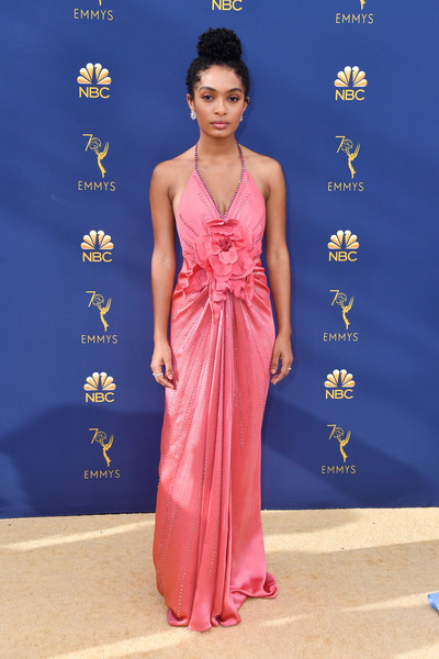Yara Shahidi caught eyes in a pink Gucci halter gown with floral detailing at the 2018 Emmys.