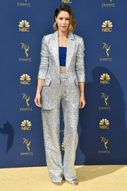 Amanda Crew looked snazzy in a silver Rasario pantsuit teamed with a cobalt crop-top at the 2018 Emmys.