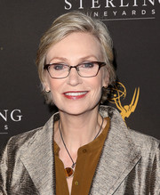 Jane Lynch opted for a casual short 'do when she attended the 2018 Emmy Awards nominees reception.