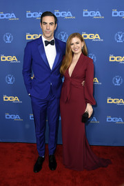 Isla Fisher chose a maroon Reem Acra gown with a plunging neckline and a knotted waist for the 2019 Directors Guild of America Awards.