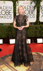 Cate Blanchett made our hearts skip a beat with this ultra-elegant black lace gown by Armani Prive during the Golden Globes.