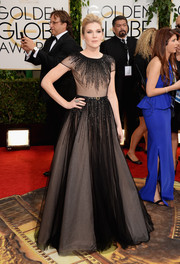 Lily Rabe looked breathtaking in a beaded black sheer-overlay gown by Georges Hobeika during the Golden Globes.