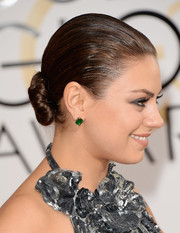 Mila Kunis accessorized with elegant emerald studs by Gemfields.