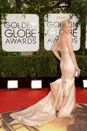 Anna Gunn went all out with the glamour in this strapless nude Donna Karan Atelier gown during the Golden Globes.